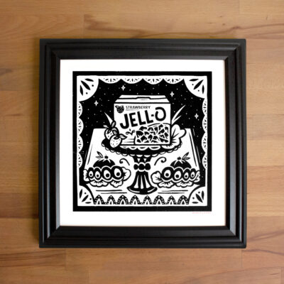 A framed picture of a strawberry Jell-O screen print.