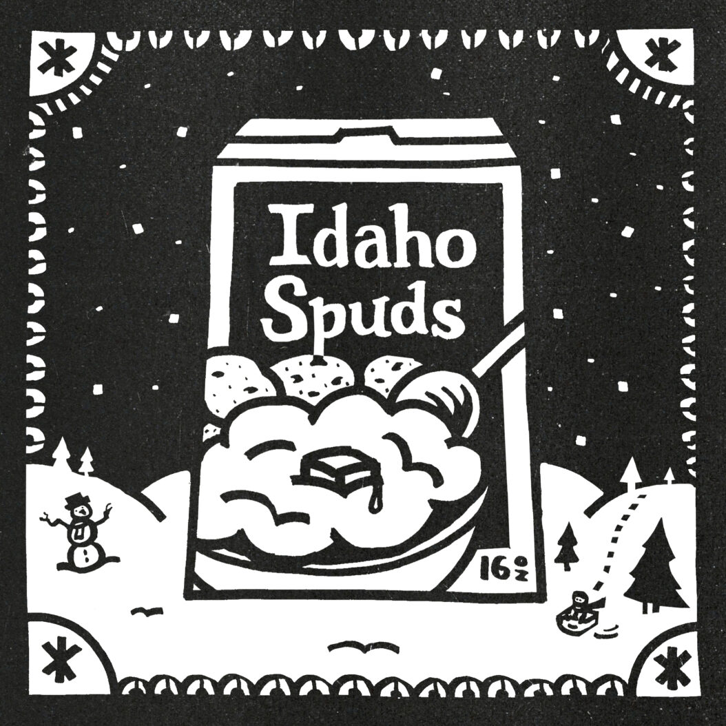 A towering box of Idaho Spuds sits in a snowy landscape. A child on a sled glides by.