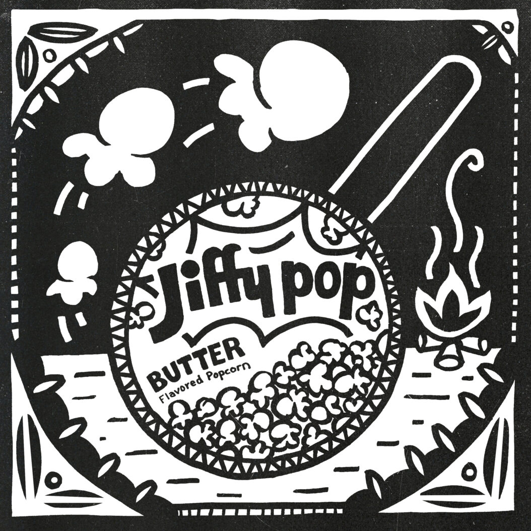A pan of Jiffy Pop sits next to a campfire in a decorative frame. Popcorn swirls around it.