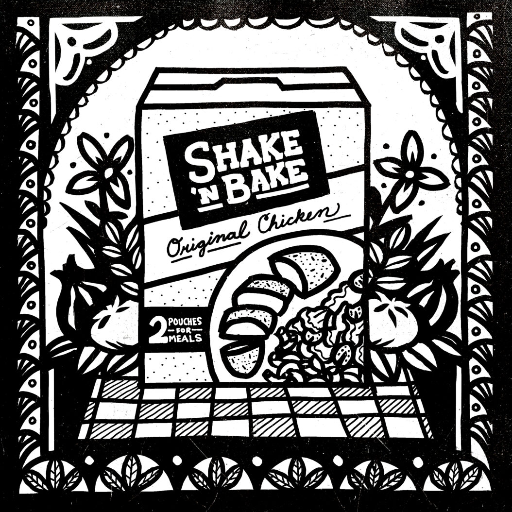 A box of Shake 'n Bake breadcrumbs sit in a tableau surrounded by tomatoes, onions and herbs.